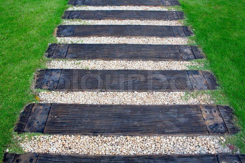 Wood stair way on green garden, stock photo