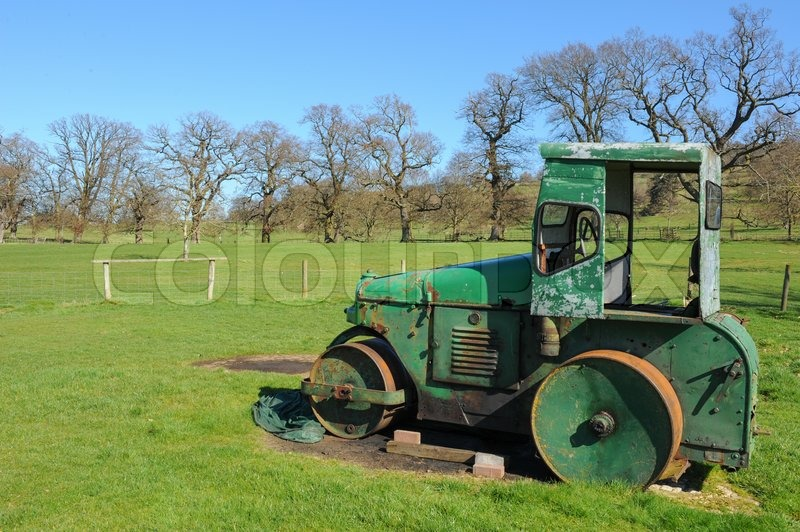 Abandoned Steam Roller at Stanway Cricket Club, Gloucestershire, England, UK, stock photo