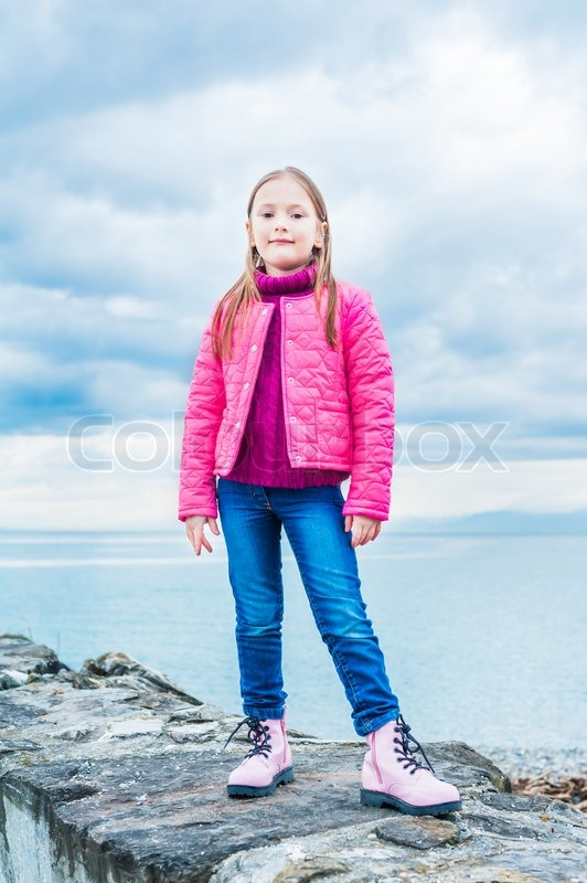 outdoor portrait of a beautiful little girl in a bright