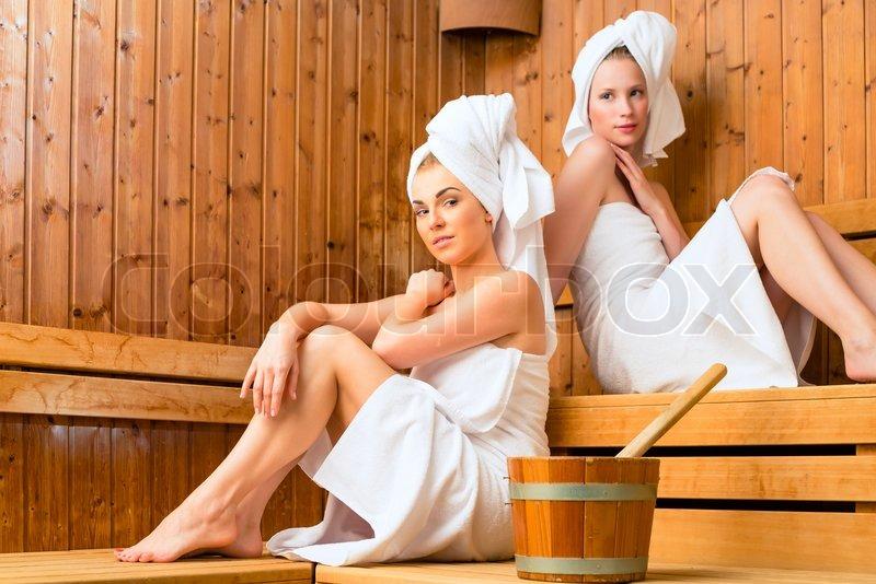 Girlfriends in wellness spa enjoying sauna infusion, stock photo