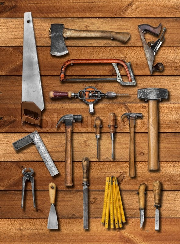 Old carpenter hand tools on wooden plank background ...
