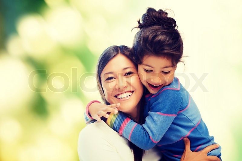 Family, children and happy people concept - hugging mother and daughter, stock photo