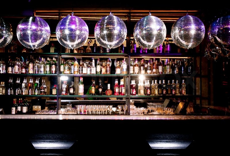 Disco bar counter with bottles in blurred background   Stock Photo ...
