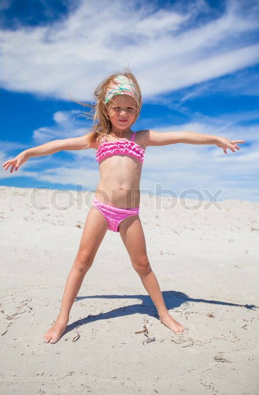 Adorable Little Girl In Beautiful Swimsuit Have Fun At