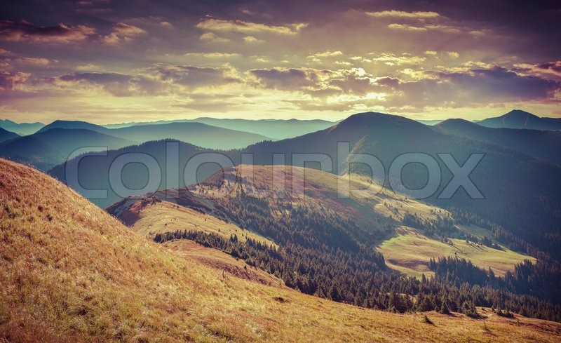 Colorful autumn landscape in mountains. Retro style, stock photo