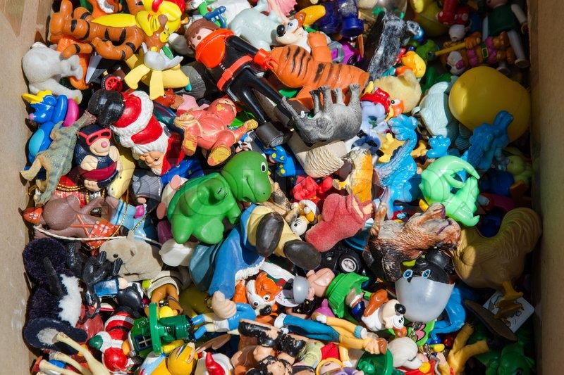 A box with multicolored old miniature toys, stock photo