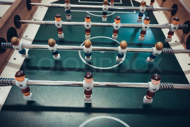 Table football game. Soccer table game, stock photo