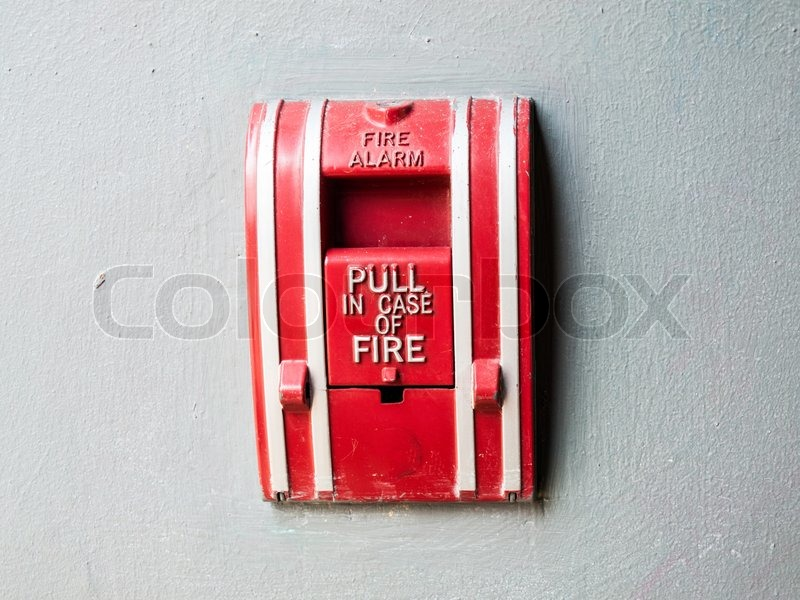 Fire alarm control panel on grey wall, stock photo