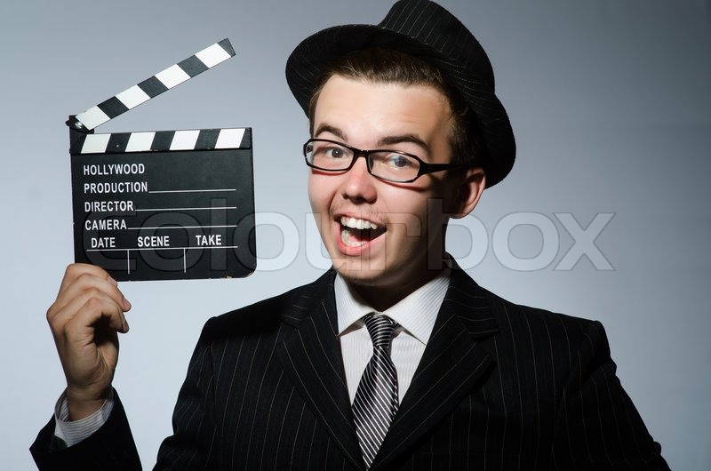Man with movie clapperboard and hat, stock photo