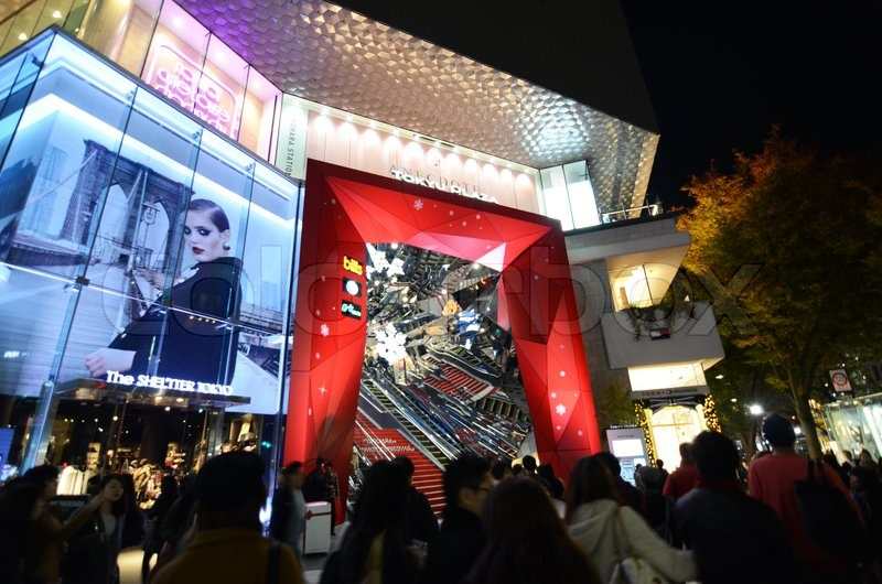 Tokyo, Japan - November 24, 2013: People shopping around Retail shops on Omotesando Street at night on November 24. 2013, Omotesando street sometimes referred to as Tokyo\'s Champs-Elysees. Here you can find famous brand name shops, cafes and restaurants f