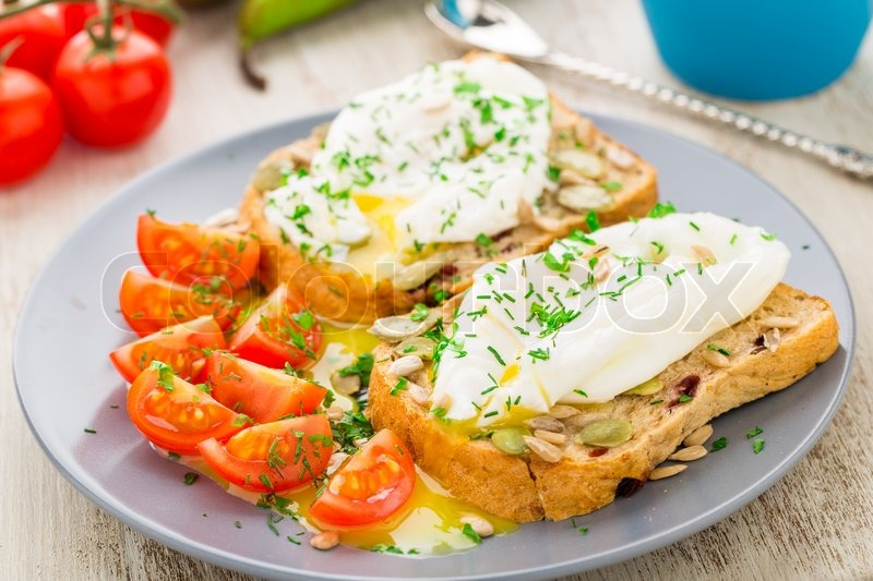 Breakfast sandwich with poached egg and cherry tomatoes. | Stock Photo ...