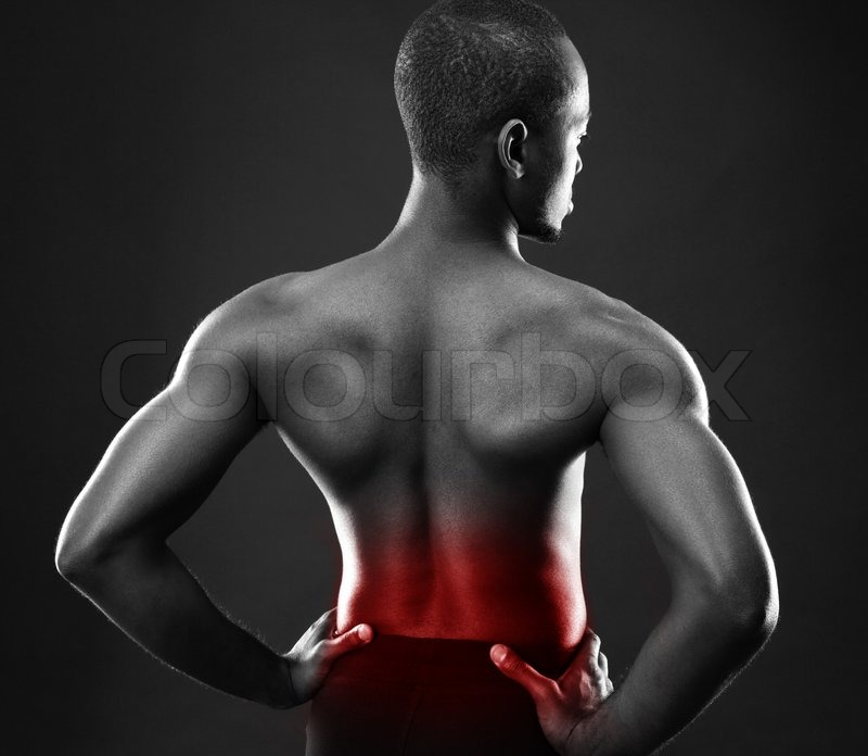 Back view portrait of a african man over black background, stock photo