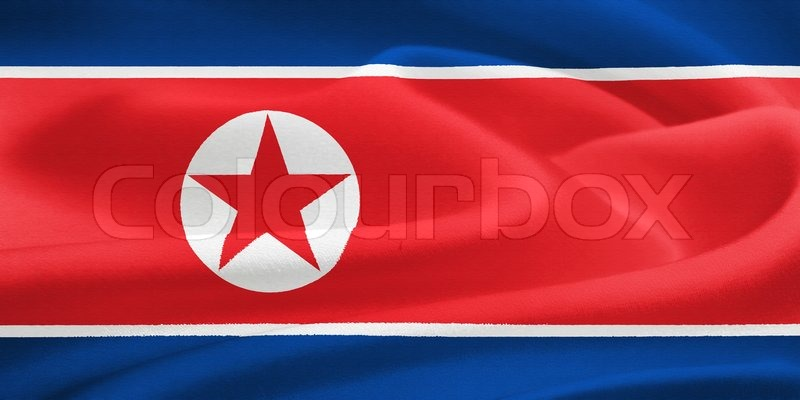 Stock image of 'flag of North Korea waving in the wind. Silk texture pattern'