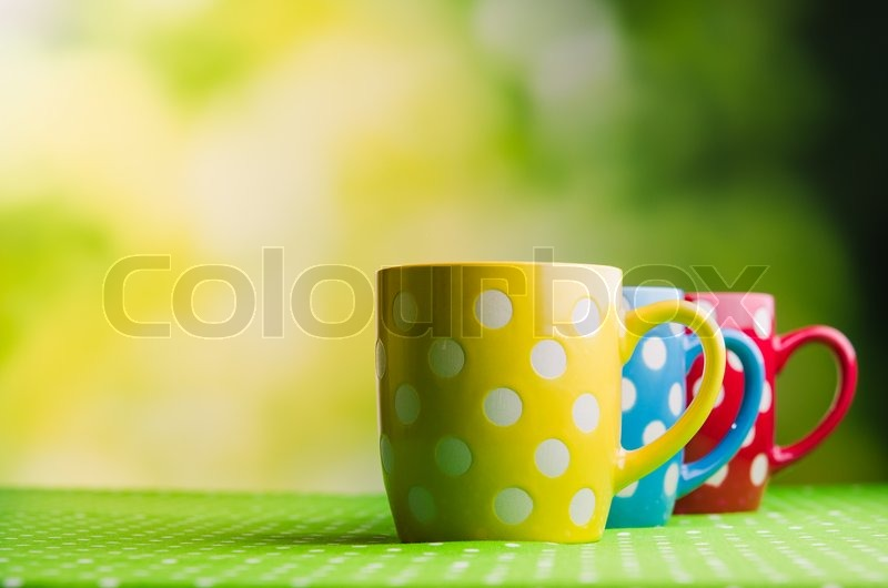 Colored coffee cups on table, stock photo