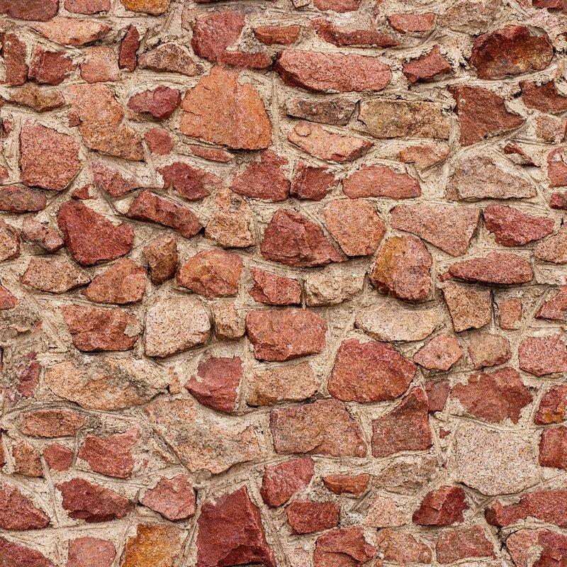 Seamless masonry wall with irregular shaped stones, stock photo
