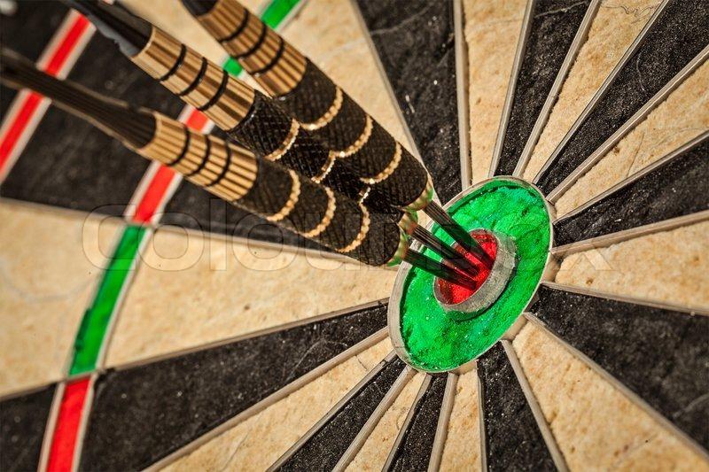 11167789-three-darts-in-bull-s-eye-close-up.jpg