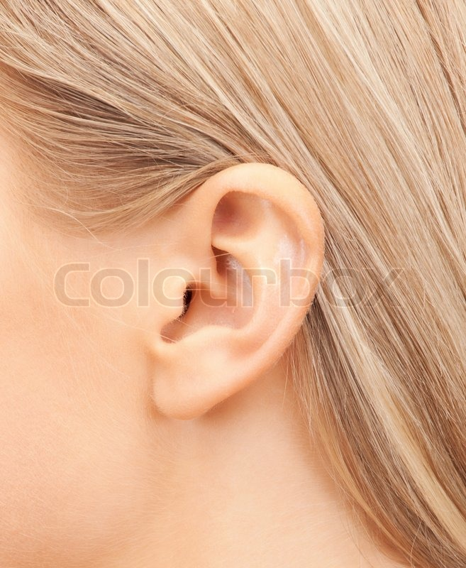 Hearing, health, beauty and piercing concept - close up of woman\'s ear, stock photo