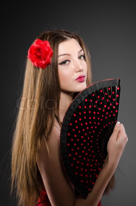 Beautiful young woman with flower and fan, stock photo
