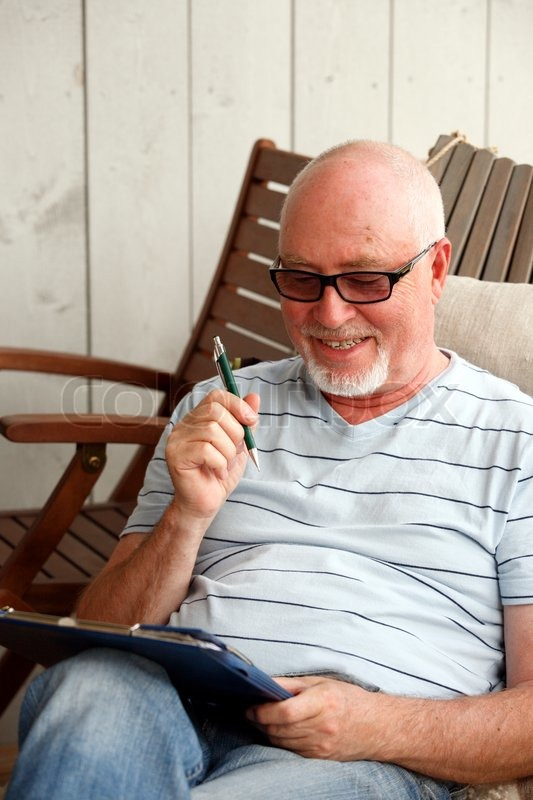 Happy retired man solving sudoku puzzle     | Stock image | Colourbox