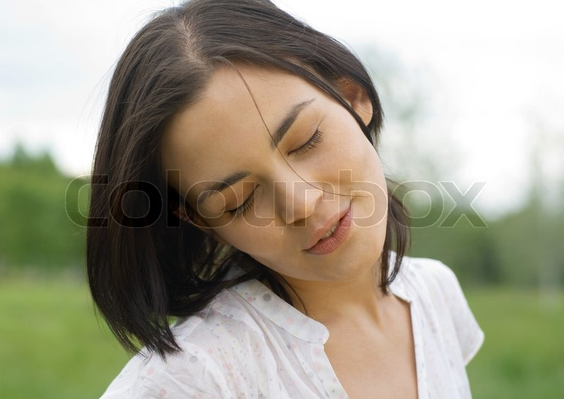 Woman closing eyes and tilting head | Stock Photo | Colourbox