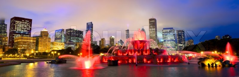 Chicago skyline panorama with Buckingham fountain in Grant Park at night, USA, stock photo