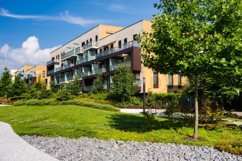 Newly built block of flats with public green area around, stock photo