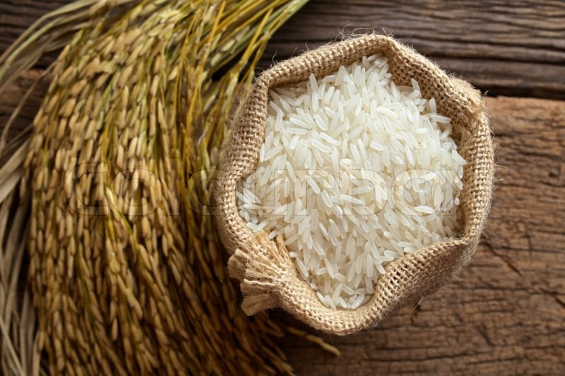 White rice in burlap sack with rice grain | Stock Photo ...