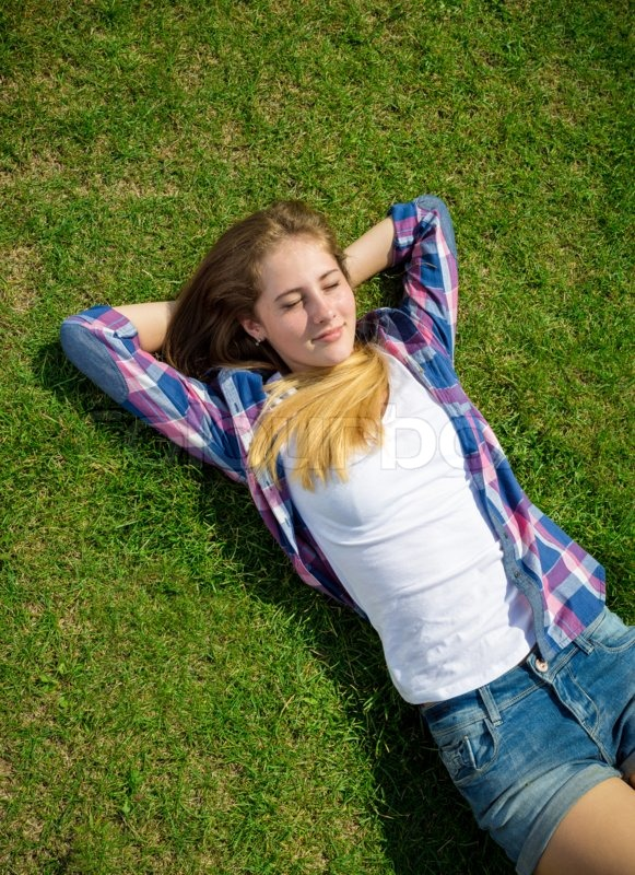 Beautiful Teenager Girl Lying On Back Stock Photo