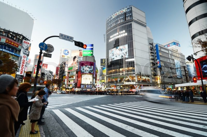 Tokyo, Japan - November 28, 2013: Crowds of people crossing the center of Shibuya district on November 28 2013, Shibuya is the most important commercial center in Tokyo, Japan , stock photo