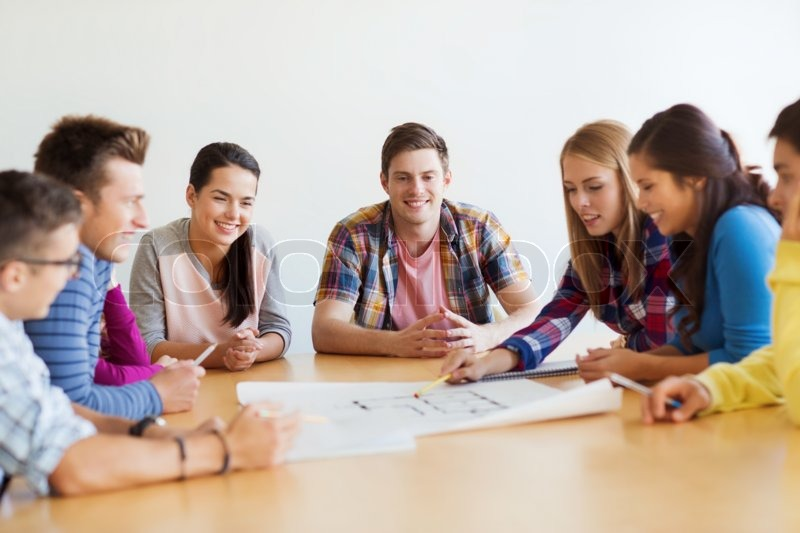 Education school architecture and people concept group of education school architecture and people concept group of smiling students with blueprint meeting indoors stock photo colourbox malvernweather Choice Image