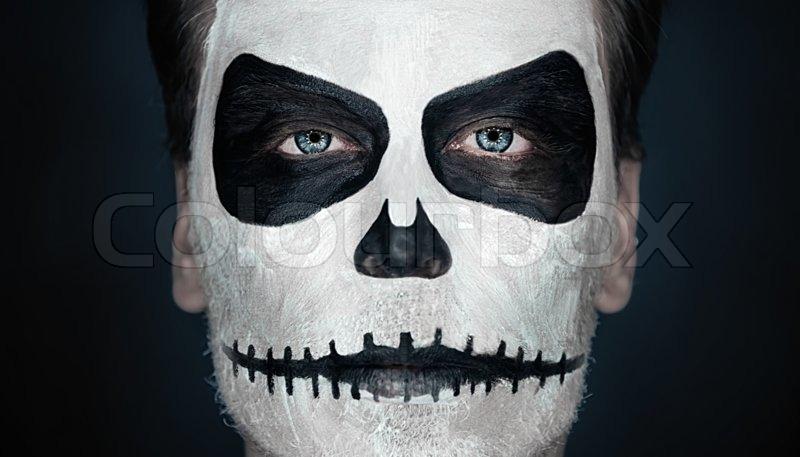 Portrait of serious man with Halloween skull makeup. Halloween or ...