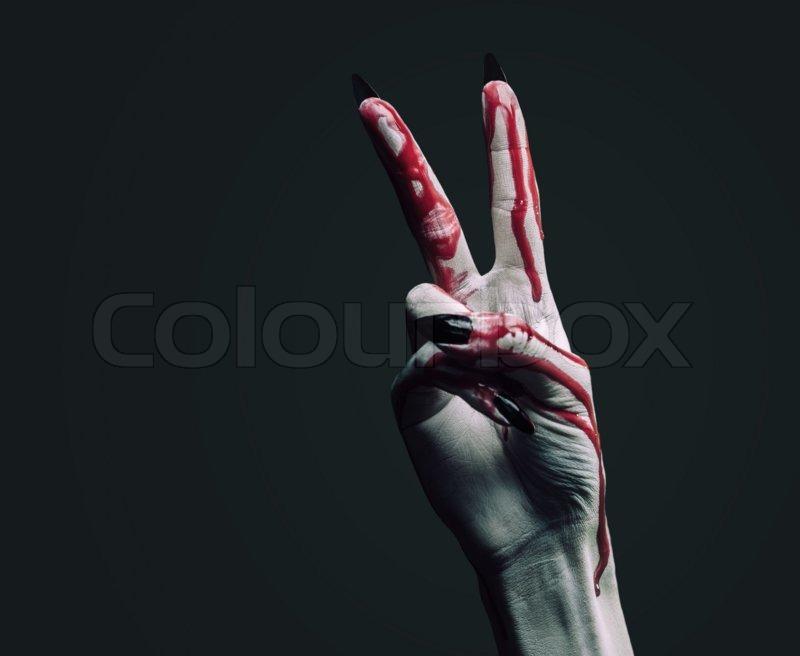 Vampire hand in blood on dark     | Stock image | Colourbox