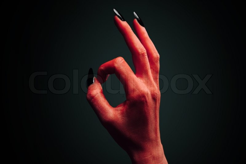 red demon or devil hand with gesture ok stock photo colourbox