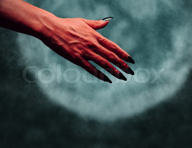 red demon or devil hand with handshake stock photo colourbox