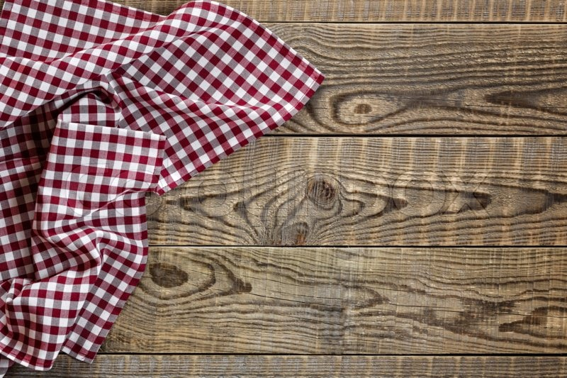 Empty wooden table with tablecloth | Stock Photo | Colourbox