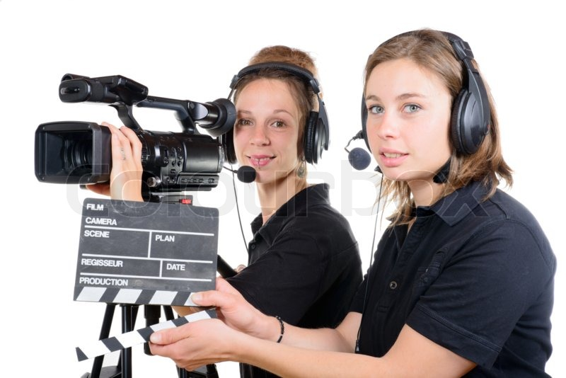 Stock image of  Two pretty young women work with a video camera  c5687c34c5