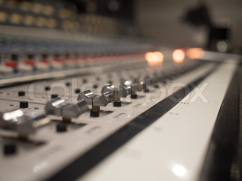 Close up Audio or Sound Mixer Sliders in a Recording Studio, stock photo