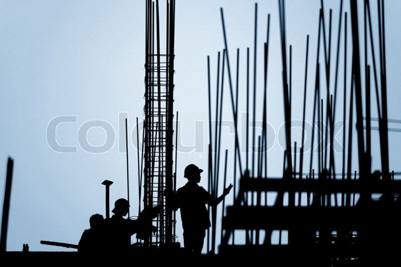 Construction worker silhouette on the work place, stock photo