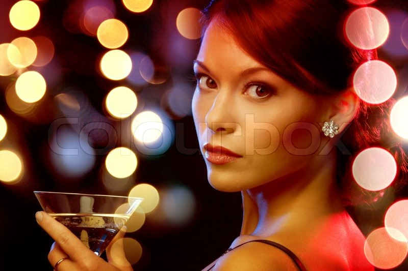 Luxury, vip, nightlife, party concept - beautiful woman in evening dress with cocktail, stock photo