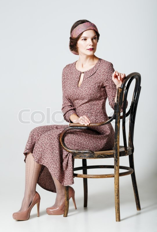 Lovely Young Woman Sitting On A Chair Portrait In Retro