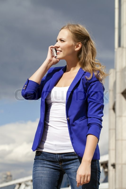 Beautiful young blonde in a blue jacket ...