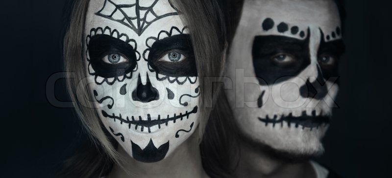 Loving young couple with sugar skull makeup. Halloween face art stock photo & Loving young couple with sugar skull makeup. Halloween face art ...