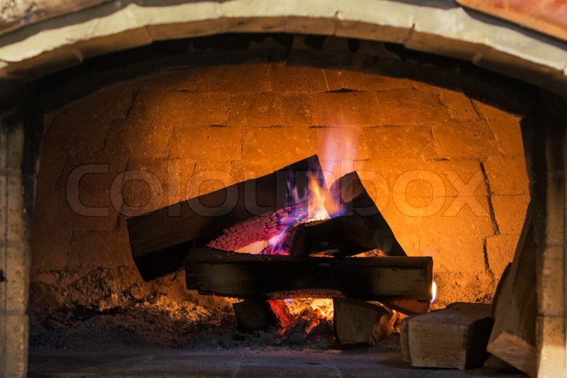 Real roaring wood fire and open brick Indoor fireplace system with ...