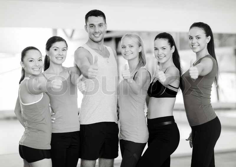 Fitness, sport, training, gym and lifestyle concept - group of happy people in the gym showing thumbs up, stock photo