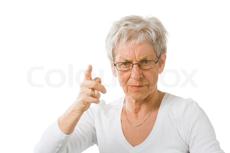 Stock foto af 'Sur ældre dame der løfter sin pegefinger'