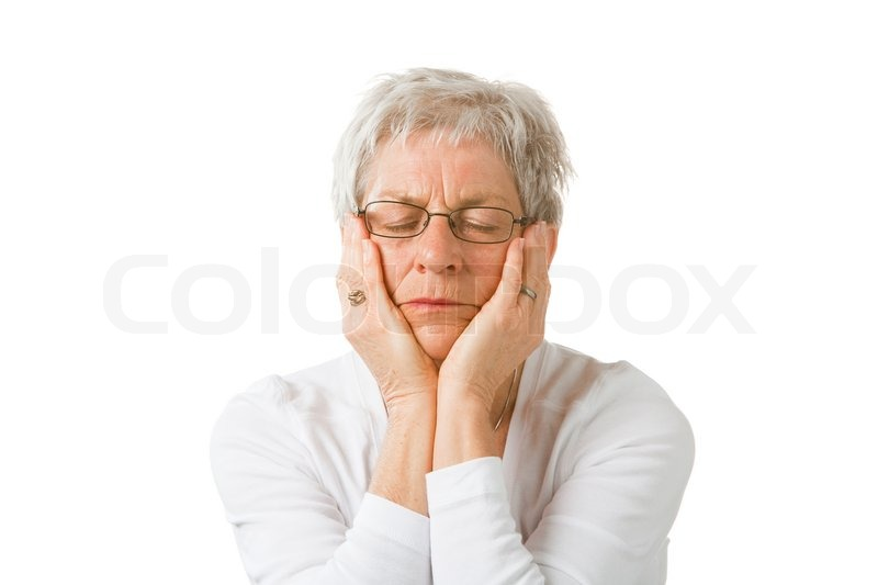 Stock image of 'An elderly caucasian woman who has a headache'