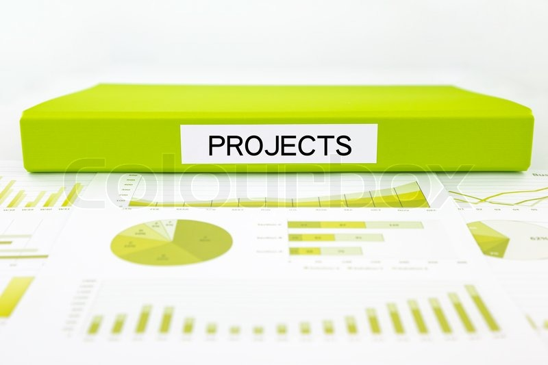 green document binder with projects word place on graphs and charts