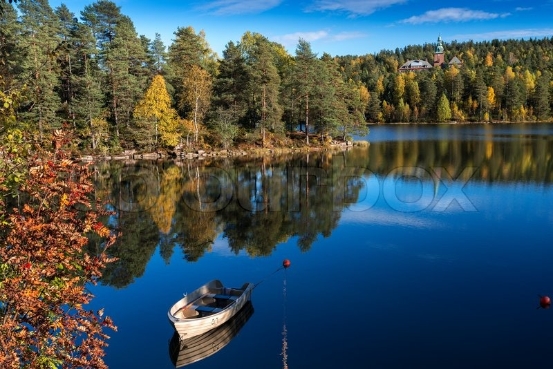 Autumn lakes at Norway boat on mooring | Stock Photo | Colourbox