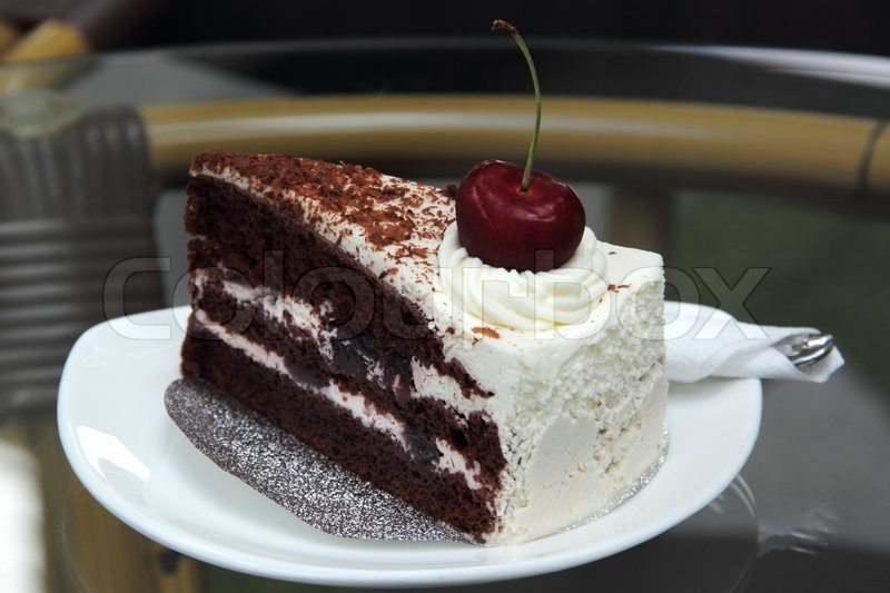 Black Forest Cake on the glass table , stock photo