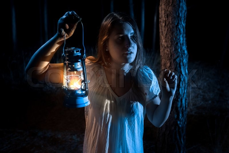 Closeup Portrait Of Scared Woman Lost In Forest Lighting